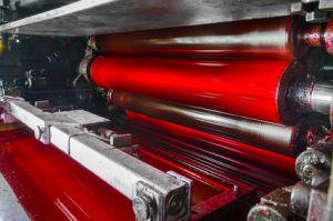 print machine, red magenda color drum, dramatic light